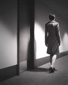 Woman Walking Down a Hallway