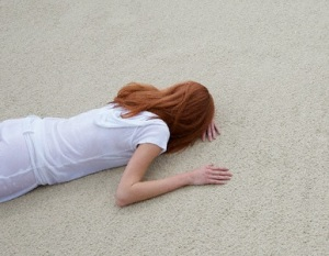 Woman Lying Face Down on Beach